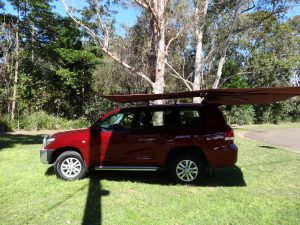 Vehicle awning 4wd camping CleverShade shade red